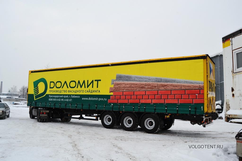 Сдвижные шторы с рекламой на полуприцеп Schmitz